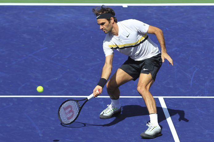 Roger Federer returns a shot to Filip Krajinovic during the third round of the BNP Paribas Open tennis tournament at the Indian Wells Tennis Garden in Indian Wells, Calif., Monday, March 12. (AP Photo/Crystal Chatham)