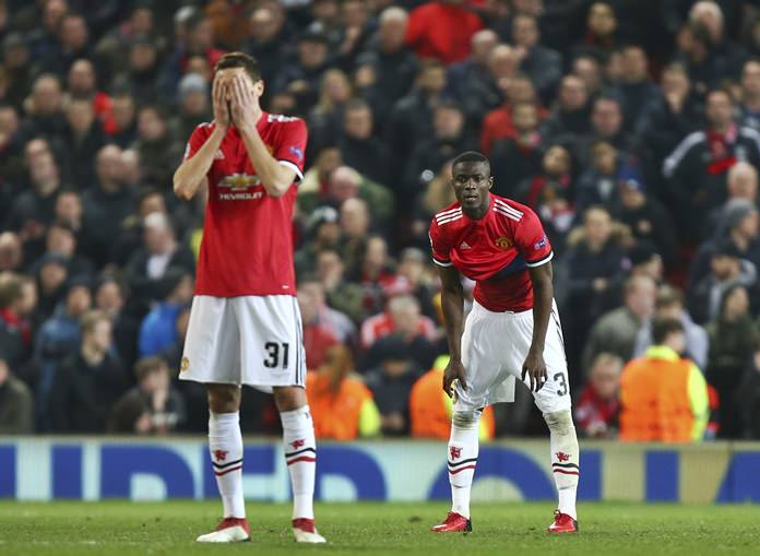 Manchester United's Nemanja Matic reacts after Sevilla scored their second goal of the game during the Champions League round of 16 second leg match at Old Trafford in Manchester, England, Tuesday, March 13. (AP Photo/Dave Thompson)
