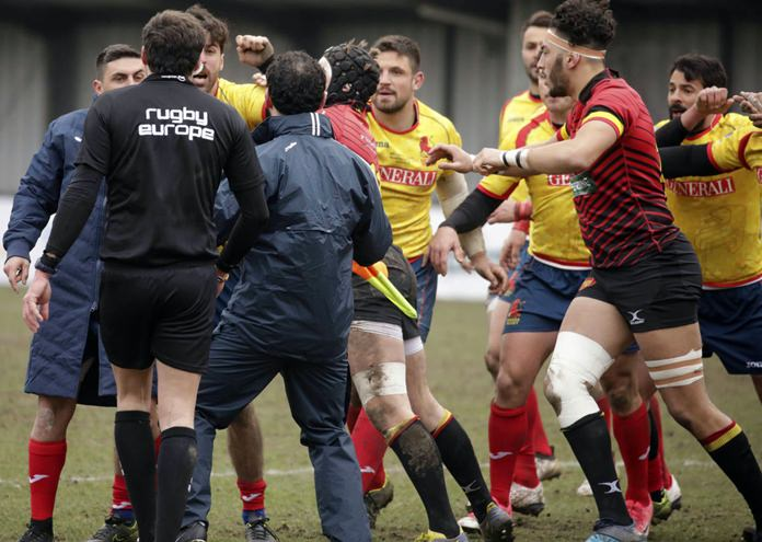 Spain players, in yellow, clash with Romania referee Vlad Iordachescu, after the Rugby Europe Championship match between Belgium and Spain at the Little Heysel Stadium in Brussels, Sunday, March 18. (AP Photo/Olivier Matthys)