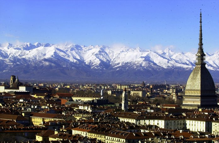 A view of Turin, Italy, with the main city landmark, the Mole Antonelliana, at right, and the Alps in background. (AP Photo/Massimo Pinca)