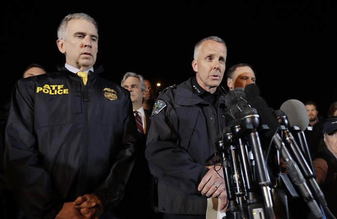 Interim Austin Police Chief Brian Manley, right, stands with other members of law enforcement as he briefs the media, Wednesday, March 21, in the Austin suburb of Round Rock, Texas. (AP Photo/Eric Gay)