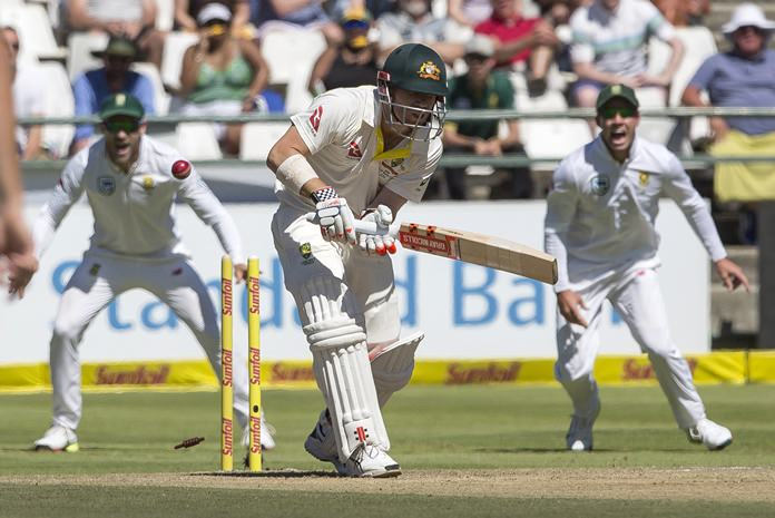 David Warner is bowled by Kagiso Rabada on the second day of the third cricket test between South Africa and Australia at Newlands Stadium, in Cape Town, South Africa, Friday, March 23. (AP Photo/Halden Krog)