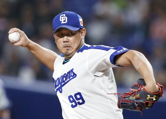 In this March 14, 2018, photo, Chunichi Dragons' Daisuke Matsuzaka pitches against the Seibu Lions during their spring training baseball game in Nagoya, central Japan. (Naoya Osato/Kyodo News via AP)