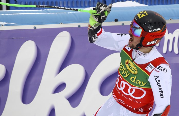 Hirscher leads slalom after 1st run, closes in on WCup title