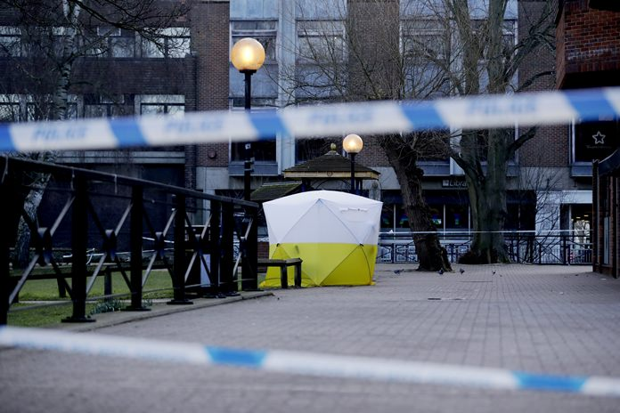 "A police tent is framed by police tape covering the spot where former Russian double agent Sergei Skripal and his daughter were found critically ill Sunday following exposure to an ""unknown substance"" in Salisbury, England, Wednesday, March 7. (AP Photo/Matt Dunham)"