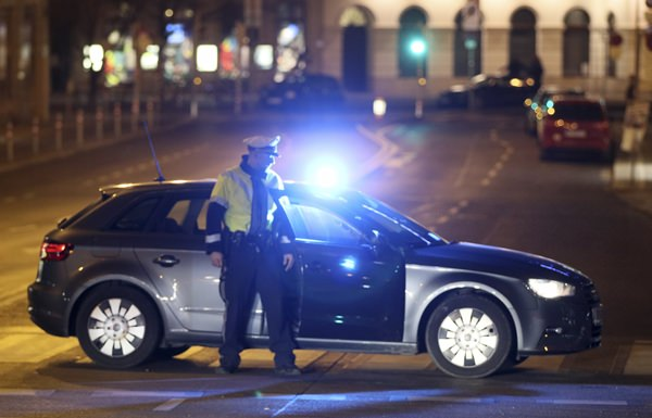 An officer blocks a street as police hunt for an attacker after several people were injured in a knife attack on the streets of Vienna, Austria, Wednesday, March 7. (AP Photo/Ronald Zak)
