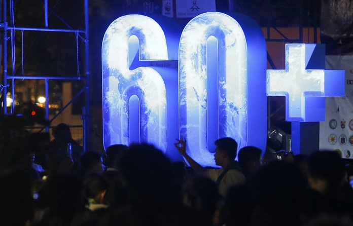 Filipinos gather at the Cultural Center of the Philippines to take part in an Earth Hour activity, a global even that raises awareness on the need to take action on climate change Saturday, March 24, 2018 in suburban Pasay city southeast of Manila, Philippines. (AP Photo/Bullit Marquez)