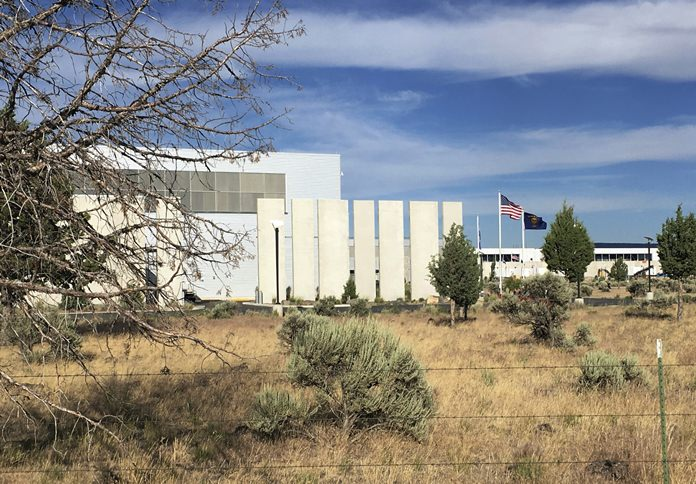 This July 1, 2016, file photo, shows the Facebook Data Center in Prineville, Ore. Facebook frequently defends its data collection and sharing activities by noting that it's adhering to a privacy policy it shares with users. (AP Photo/Andrew Selsky, File)