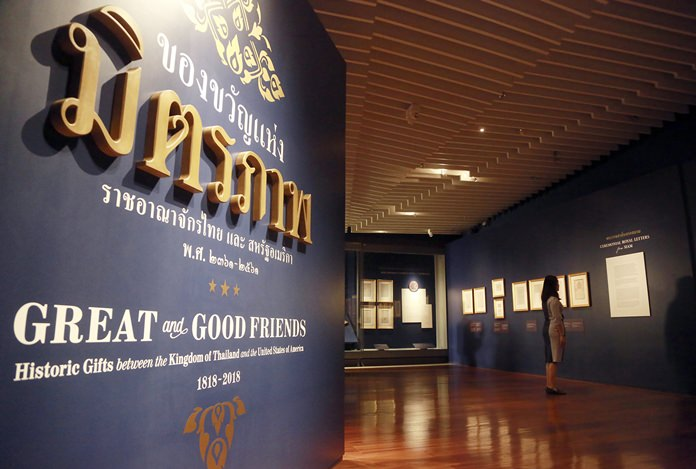 """A visitor tours the exhibition titled """"Great and Good Friends,"""" inside the Grand Palace in Bangkok. (AP Photo/Sakchai Lalit)"""