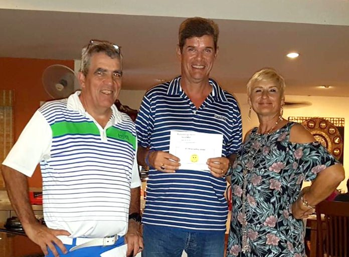 A flight winner Dani Grob (centre) receives his prize from Chrusi and Monika.
