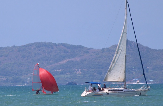 A Laser Standard and a monohull sail during the 2018 PC Classic.