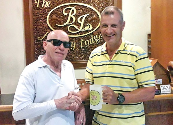Richard Kubicky (right) being presented with the mug by BJ.