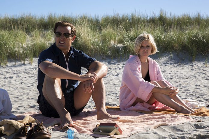 """This image shows Jason Clarke as Ted Kennedy (left) and Kate Mara as Mary Jo Kopechne in a scene from """"Chappaquiddick."""" (Claire Folger/Entertainment Studios via AP)"""