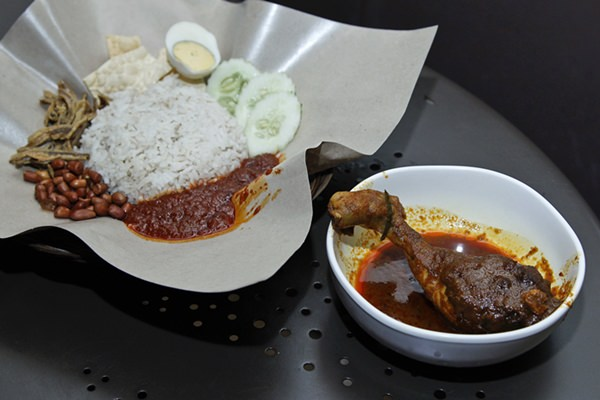 Malaysia's national dish, Nasi Lemak and chicken rendang, are shown at a restaurant in Subang Jaya, Malaysia, Tuesday, April 3. (AP Photo/Sadiq Asyraf)