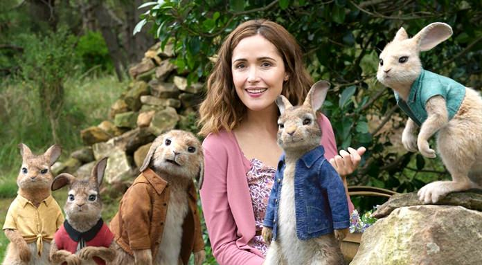 """This image shows Rose Byrne with characters (from left) Mopsy, voiced by Elizabeth Debicki, Flopsy, voiced by Margot Robbie, Benjamin Bunny, voiced by Colin Moody, Peter Rabbit, voiced by James Corden and Cottontail, voiced by Daisy Ridley in a scene from """"Peter Rabbit."""" (Columbia Pictures/Sony via AP)"""
