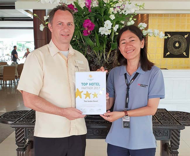 "Thai Garden Resort Hotel Manager Danilo Becker (left) and Kalayanee, representing Go Vacation Thailand, proudly display Thai Garden Resort's ""Top Hotel Partner 2017"" award from Schauinsland Travel in Germany."