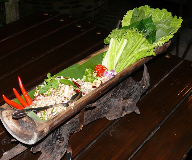 Fish larb presented in bamboo.