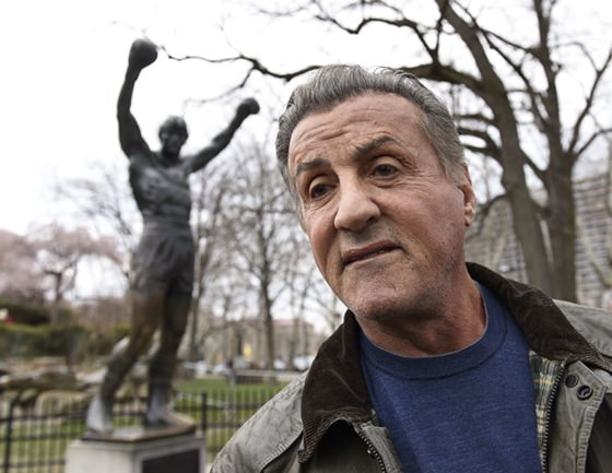 "Sylvester Stallone talks to reports in front of the Rocky statue for a ""Creed II"" photo op, Friday, April 6 in Philadelphia. The film, part of the ""Rocky"" film franchise, will be released later this year. (AP Photo/Michael Perez)"