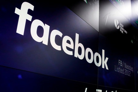 """Facebook will begin alerting users whose private data may have been compromised in the Cambridge Analytica scandal starting Monday, April 9. All 2.2 billion Facebook users will receive a notice on their feeds titled """"Protecting Your Information."""" It will have a link to information on which Facebook apps they use and what information they have shared with those apps. (AP Photo/Richard Drew, File)"""