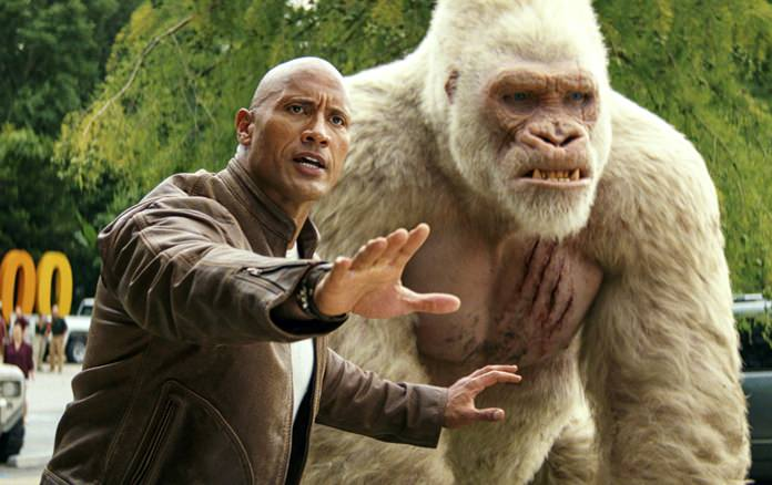 """This image released by Warner Bros. shows Dwayne Johnson in a scene from """"Rampage."""" (Dwayne Johnson via AP)"""