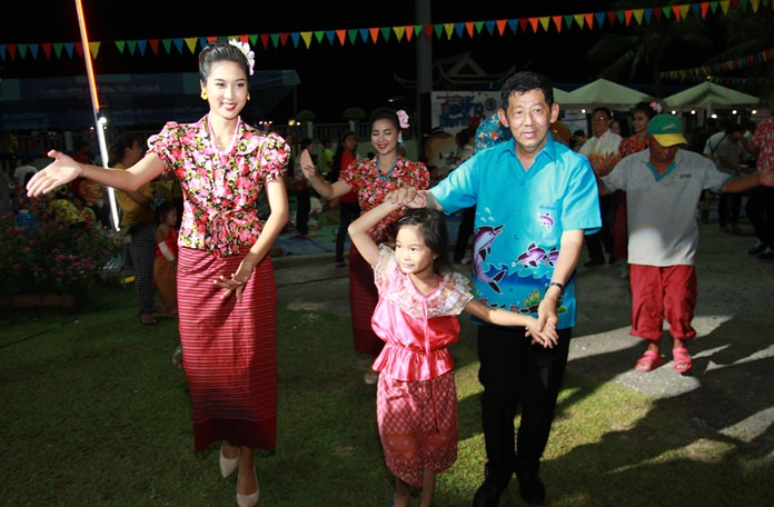 Pattaya Mayor Pol. Maj. Gen. Anan Charoenchasri dances the ramwong with family and friends during the festival.