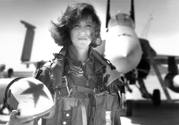In this image provided by the U.S. Navy, Lt. Tammie Jo Shults, one of the first women to fly Navy tactical aircraft, poses in front of an F/A-18A with Tactical Electronics Warfare Squadron (VAQ) 34 in 1992. (Thomas P. Milne/U.S. Navy via AP)