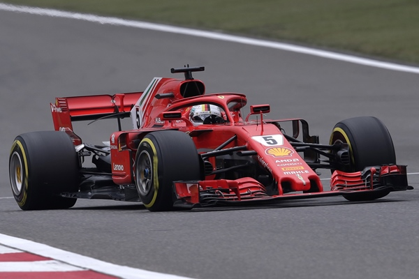 Ferrari driver Sebastian Vettel of Germany steers his car during the qualifying session for the Chinese Formula One Grand Prix at the Shanghai International Circuit in Shanghai, Saturday, April 14. (AP Photo/Andy Wong)