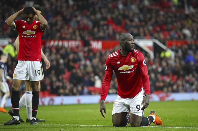 Manchester United's Romelu Lukaku shows his dejection after the final whistle of the English Premier League soccer match against West Bromwich Albion at Old Trafford, Manchester, Sunday April 15. (Nick Potts/PA via AP)