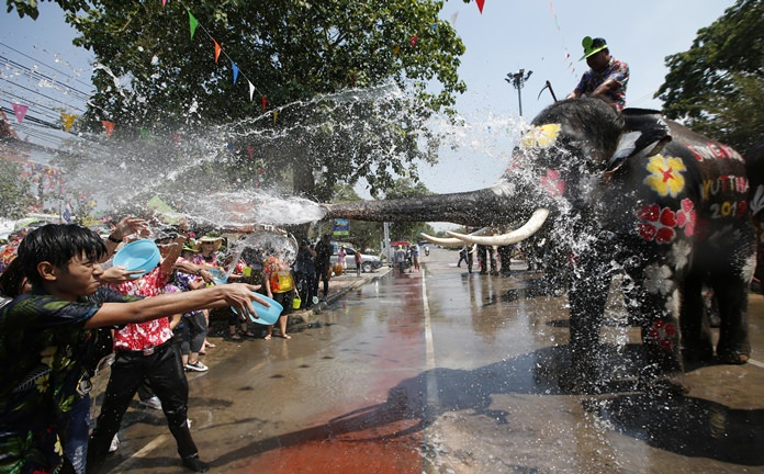 With assistance from its mahout, an elephant blows water from its trunk to locals and tourists in Ayutthaya province, central Thailand. The annual Songkran festival, which heralds the traditional beginning of the Thai New Year, is celebrated throughout the country. Once again, officials down here on the coast are calling for a more cultural approach to what has turned into 10 days of water splashing fun for some and madness for others. Locally, the wet and wild celebrations are supposed to take place a week later, on April 18 in Naklua and April 19 in Pattaya. But we all know this doesn't happen, no matter who's in charge. Note: On Thursday April 19, Beach Road Pattaya will be closed from 6 a.m. to 7 p.m.  (AP Photo/Sakchai Lalit)