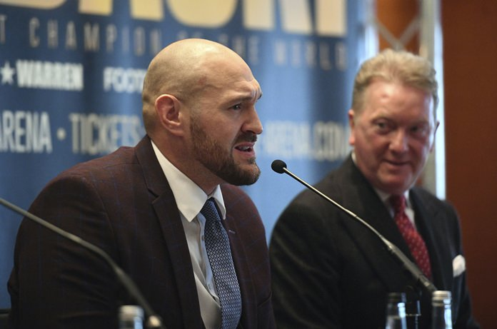 Former world heavyweight boxing champion Tyson Fury talks during a press conference to announce his return to the ring, in London, Thursday April 12. (Victoria Jones/PA via AP)