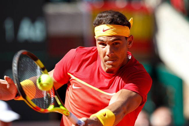 In this Sunday April 8, 2018 file photo, Spain's Rafael Nadal returns the ball to Germany's Alexander Zverev during a World Group quarterfinal Davis Cup tennis match between Spain and Germany at the bullring in Valencia, Spain. (AP Photo/Alberto Saiz)