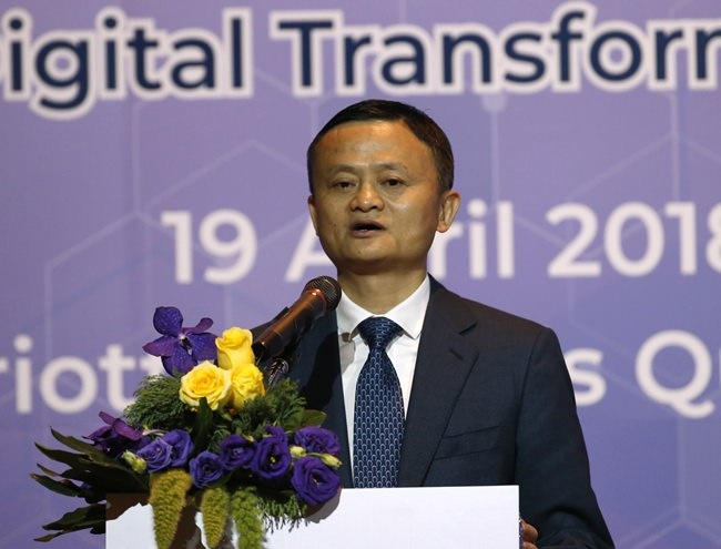 Founder and chairman of Alibaba Jack Ma delivers a speech before signing four memorandums of understanding linked to the investment in Thailand during a press conference Bangkok, Thursday, April 19. (AP Photo/Sakchai Lalit)