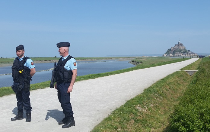 Police attend the scene of an evacuation at Mont Saint-Michel, on France's northern coast, Sunday April 22. (AP Photo/Randall Hackley)