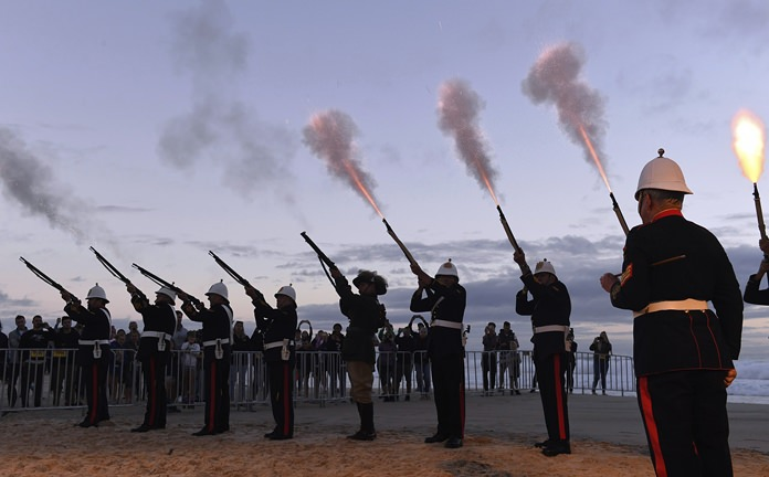 Australian military veterans fire into the air during the ANZAC Day dawn service at Elephant Rock in Currumbin on the Gold Coast, Australia, Wednesday, April 25. (Dave Hunt/AAP Image via AP)