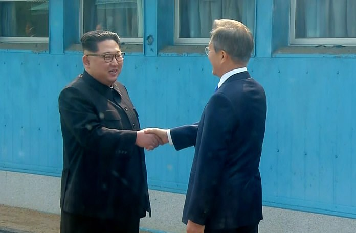 In this image provided by Korea Broadcasting System (KBS) Friday, April 27, North Korean leader Kim Jong Un, left, shakes hands with South Korean President Moon Jae-in as Kim crossed the border into South Korea for their historic face-to-face talks, in Panmunjom. (Korea Broadcasting System via AP)
