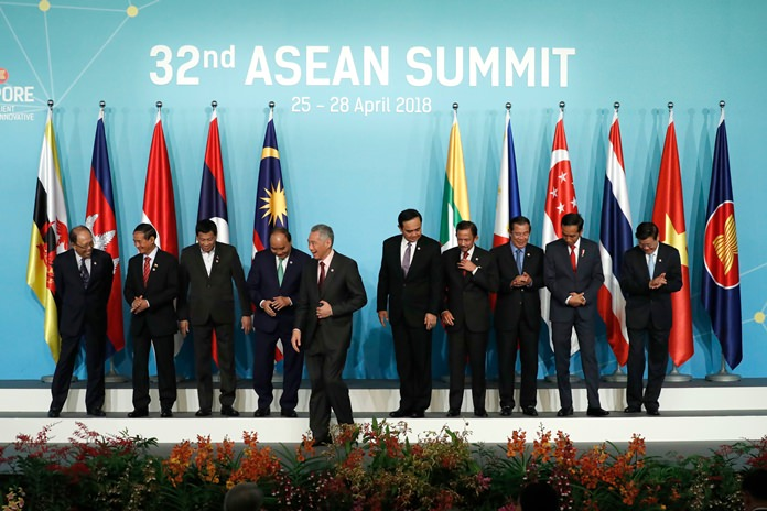 Leaders and country representatives from left to right; Malaysia's Former Deputy Prime Minister Tun Musa Hitam, Myanmar President Win Myint, Philippine President Rodrigo Duterte, Vietnam's Prime Minister Nguyen Xuan Phuc, Singapore's Prime Minister Lee Hsien Loong, Thailand's Prime Minister Prayuth Chan-ocha, Brunei's Sultan Hassanal Bolkiah, Cambodia's Prime Minister Hun Sen, Indonesia's President Joko Widodo, and Laos Prime Minister Thongloun Sisoulith, leave the stage after their group photo during the opening ceremony of the 32nd ASEAN Summit on Saturday, April 28, 2018, in Singapore. (AP Photo/Yong Teck Lim)