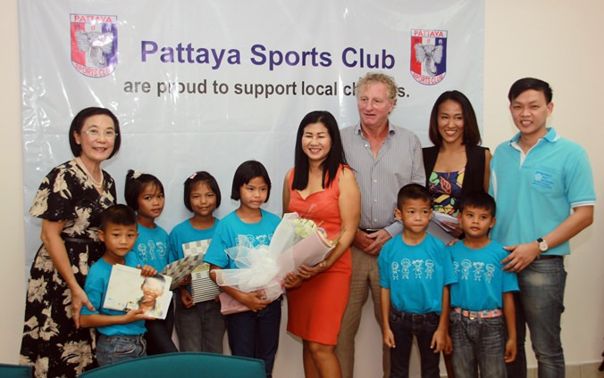 HHNFT Director Radchada Chomjinda (left) graciously accepts a donation from Pattaya Sports Club President Maurice Roberts and Social Welfare Chairwoman Noi Emerson.