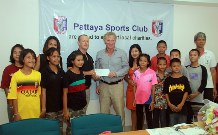 Fr. Ray Foundation representative Derek Franklin (center left), receives a benevolent donation from Pattaya Sports Club President Maurice Roberts and Social Welfare Chairwoman Noi Emerson.