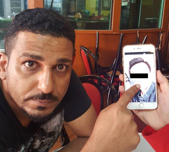 Al Safi Saeed Al Safi Ba Wazir points to a photo he took on his phone of Budsaba Kantiya who he says stole money from him.
