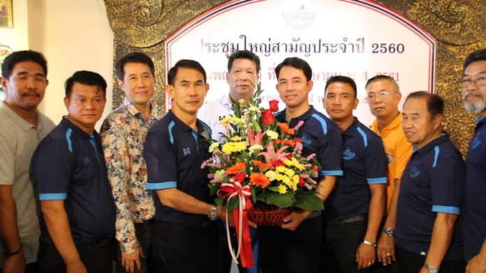 Friends and colleagues congratulate Pattaya's ex-Mayor Itthiphol Kunplome (center, right) on his appointment as an assistant to the Tourism and Sports Minister.