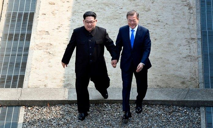 North Korean leader Kim Jong Un, left, and South Korean President Moon Jae-in cross the military demarcation line at the border village of Panmunjom. (Korea Summit Press Pool via AP, File)