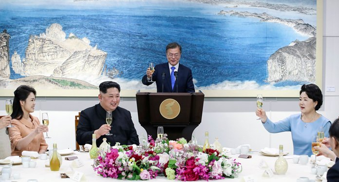 North Korean leader Kim Jong Un, second from left, holds a glass with his wife Ri Sol Ju, left, South Korean President Moon Jae-in and Moon's wife Kim Jung-sook, right, during a dinner banquet. (Korea Summit Press Pool via AP. File)