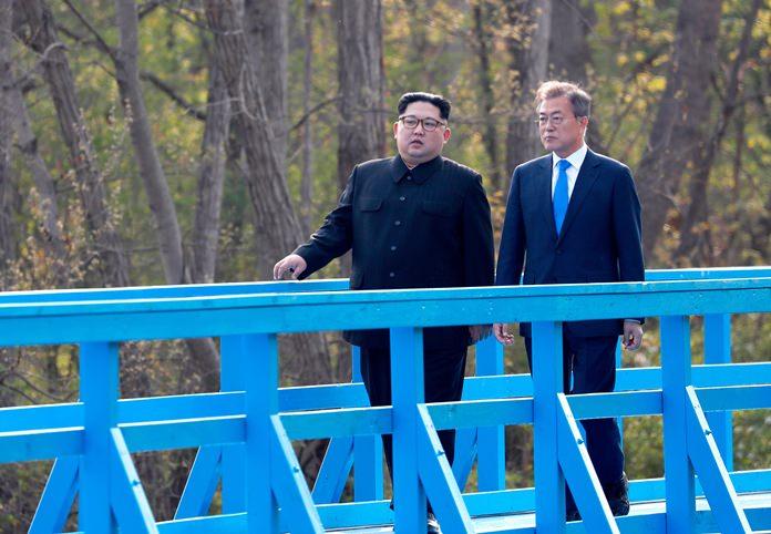 North Korean leader Kim Jong Un, left, and South Korean President Moon Jae-in talk as they walk on a footbridge. (Korea Summit Press Pool via AP, File)