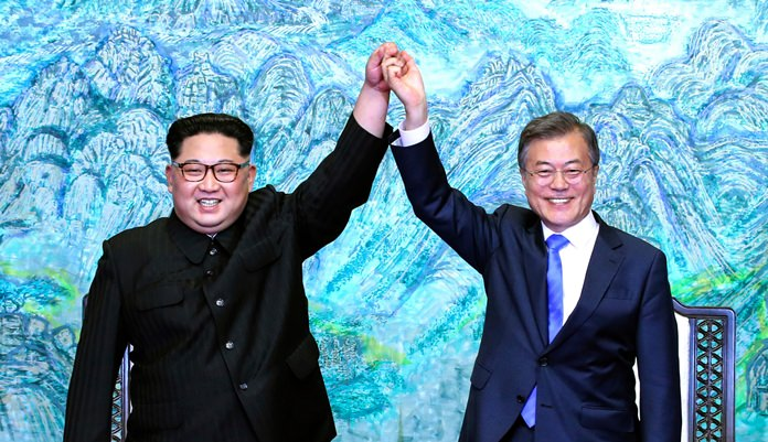 North Korean leader Kim Jong Un, left, and South Korean President Moon Jae-in raise their hands after signing the Panmunjom Declaration. (Korea Summit Press Pool via AP, File)