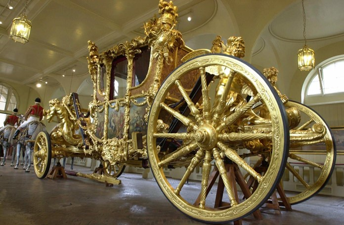 The Queen's Gold State Coach in the Royal Mews in Buckingham Palace, in London. (AP Photo/Richard Lewis, File)