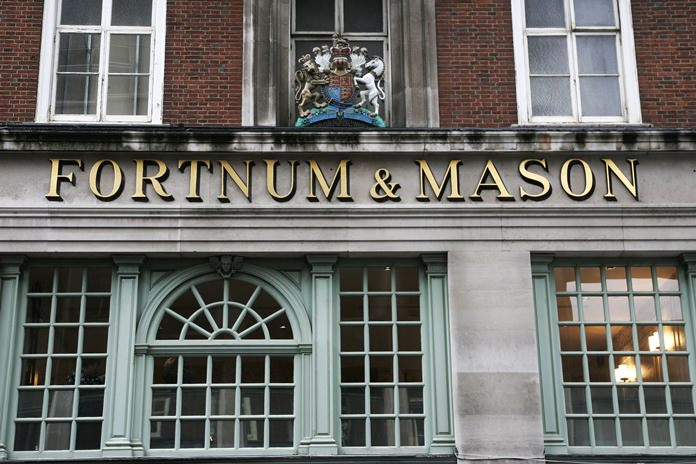 The Fortnum & Mason store in London, also bearing the Royal Coat of Arms above, declaring by appointment to Her Majesty Queen Elizabeth II. (AP Photo/Sang Tan, File)