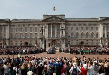 Queen Elizabeth II leaves Buckingham Palace with Prince Charles to travel to parliament for her speech at the official State Opening of Parliament in London. (AP Photo/Frank Augstein, File)