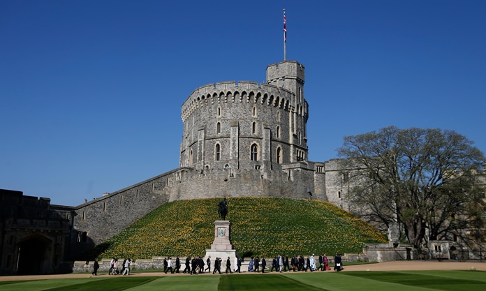 Leaders of Commonwealth countries arrive and walk past the round tower at Windsor Castle for the second day of the Commonwealth Heads of Government 2018 for a behind closed doors meeting in Windsor, England. (AP Photo/Frank Augstein, File)