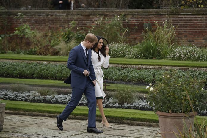 Britain's Prince Harry and his fiancée Meghan Markle pose for photographers during a photocall in the grounds of Kensington Palace. (AP Photo/Matt Dunham, File)