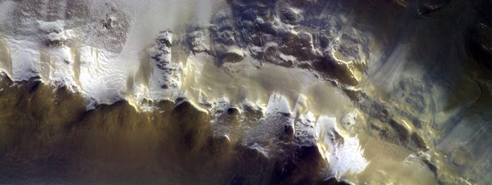 The European Space Agency has released its first image taken by a probe orbiting Mars, showing the ice-covered edge of a vast crater. (ESA/Roscosmos/CaSSIS via AP)